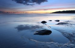 Puesta del sol sobre Lyme Regis Imagen de archivo libre de regalías