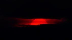 Puesta del sol sobre negro Fotos de archivo