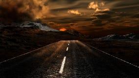 Puesta del sol sobre un camino Fotografía de archivo libre de regalías