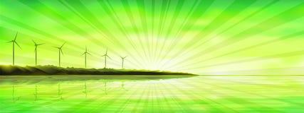 Puesta del sol sobre una isla del océano con las turbinas de viento Fotos de archivo libres de regalías