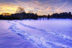 Puesta del sol sobre una pradera de cercano oeste Foto de archivo libre de regalías