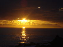 Puesta del sol surafricana sobre el mar imagen de archivo