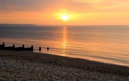 Puesta del sol tranquila de la marea baja Imágenes de archivo libres de regalías
