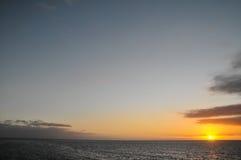 Puesta del sol tropical de Clorful Foto de archivo