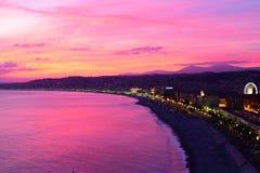 Puesta del sol viva sobre el mediterráneo - Niza, Francia fotos de archivo