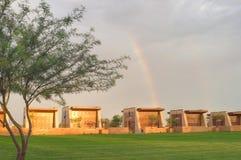 Puesta del sol y arco iris en un cementerio Foto de archivo libre de regalías