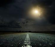 Puesta del sol y camino Imagen de archivo libre de regalías