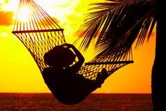 Puesta del sol y hamaca Fotos de archivo libres de regalías