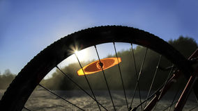 Puesta del sol y la bici Imagen de archivo