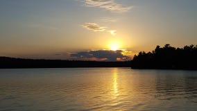 Puesta del sol y la nube Imagenes de archivo