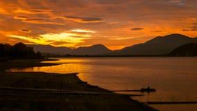 Puesta del sol y lago Imagen de archivo