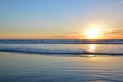 Puesta del sol y océano Foto de archivo libre de regalías