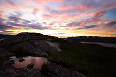 Puesta del sol y paisaje de la oscuridad Imagen de archivo libre de regalías