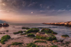 Puesta del sol y paisaje marino foto de archivo