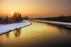 Puesta del sol y río Foto de archivo
