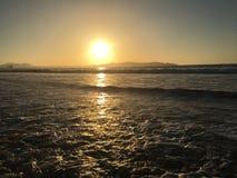 puesta del sol y salidas del sol Fotos de archivo libres de regalías