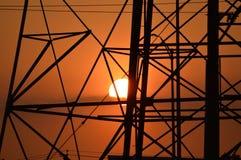 Puesta del sol y torres Imagen de archivo
