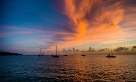 Puesta del sol y veleros Imagen de archivo libre de regalías