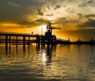 Puesto avanzado del guardacostas en la puesta del sol Imagen de archivo