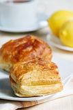Puff buns, lemons and tea royalty free stock photography