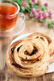 Puff buns with raisin and cup of tea Royalty Free Stock Image