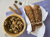 Puff buns and walnuts Stock Photos