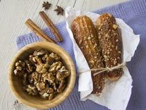 Puff buns and walnuts Stock Photos