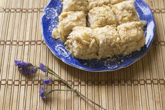 Puff cakes on blue dish, napoleon cakes Stock Images