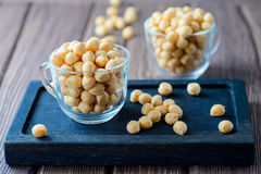 Puff croutons, small pastry balls, soup additive. On a wooden background Royalty Free Stock Images