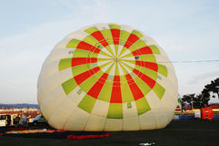 Inflating an Hot Air Balloon - Sunrise. Hot air balloon on the ground, during ninth Crossing of Portugal Hot Air Balloons, Bragança, Portugal. Picture taken Royalty Free Stock Images