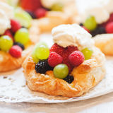 Puff pastries. With berry fruits and whipping cream Stock Photo