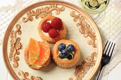 Puff pastries with custard and fruit Royalty Free Stock Photo