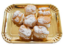Puff pastries filled with cream. Stock Images