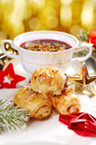 Puff pastries and red borscht for christmas eve Royalty Free Stock Photo
