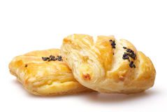 Puff pastry. With sesame on white background Stock Photos