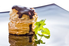 Puff pastry. And chocolate cake on a china plate black on white background Royalty Free Stock Photo