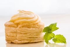 Puff pastry. On a china plate black on white background Royalty Free Stock Photo