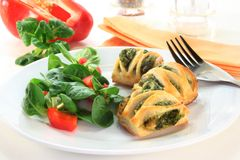 Puff pastry. With a spinach-cheese filling and corn salad Stock Photography
