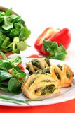 Puff pastry. With a spinach-cheese filling and corn salad Royalty Free Stock Photos