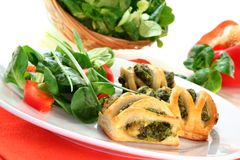 Puff pastry. With a spinach-cheese filling and corn salad Royalty Free Stock Images