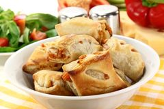 Puff pastry. Savory pastry snacks filled with red pepper and vegetables Stock Images