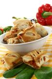 Puff pastry. Savory pastry snacks filled with red pepper and vegetables Stock Image
