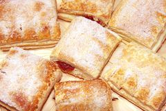 Puff pastry. With jam on straw plate, close-up Royalty Free Stock Images