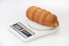 Puff pastry from bakery on a digital scale Stock Photo