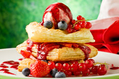 Puff pastry with berries and ice cream Stock Photos