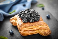 Puff pastry with blackberries. On slate plate Stock Photos
