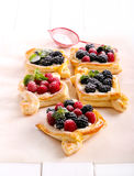Puff pastry cakes with cream filling Stock Image
