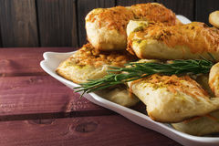 Puff pastry with cheese and herbes de Provence on wooden planks toned selective focus Stock Image