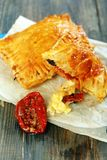 Puff pastry with cheese and sun-dried tomato. Royalty Free Stock Images