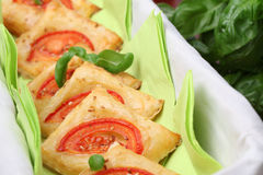 Puff pastry with cheese and tomatoes Stock Photography